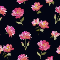 Embroidery seamless pattern with pink flowers on black background. Imitation of satin stitch. Vector illustration.