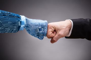 Obraz Two Businesspeople Making Fist Bump - fototapety do salonu