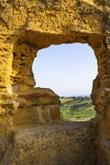 Sicilian landscape framed by the ruins of early medieval necropolis at Valle dei Templi (Valley of the Temples), Agrigento, Sicily, Italy