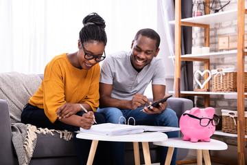 Couple Calculating Invoice
