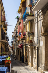 Colorful alley in Cefalù historc center, Palermo province, Sicily, Italy