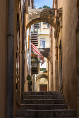 Stairway in a typical narrow in Cefalù historic center, Palermo province, Sicily, Italy
