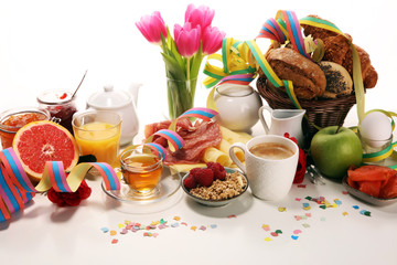 breakfast on table with bread buns, croissants, coffe and juice on carnival