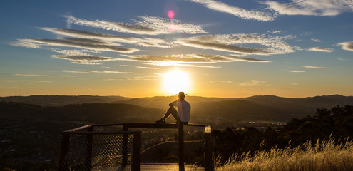 Young man is looking at the sunset, New South Wales, Australia