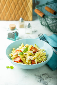 Pasta salad with tomato and chicken