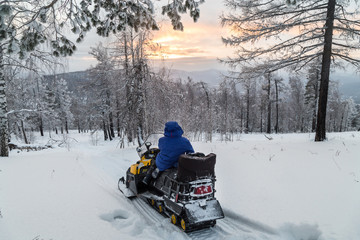 Athlete on a snowmobile.