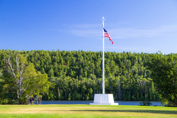 Historic Fort. American flag and canon at Fort Wilkins State Historic Park is a remote military outpost in the Upper Peninsula of Michigan.