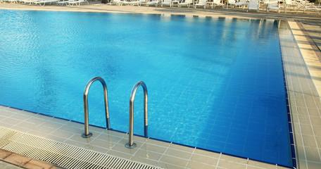 steps in blue water pool