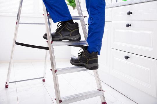 Man Stepping On Ladder