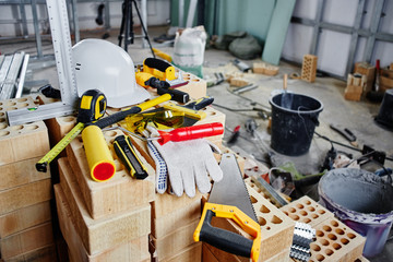 Home repairs. Construction tools, bricks and helmet
