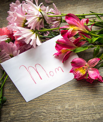 Mother's Day. Mother's Day card with a fresh bouquet of flowers in vertical orientation.