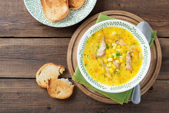 Creamy corn soup with vegetables and meat.