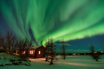 Foto op Plexiglas Noorderlicht Aurora over cottage in Iceland