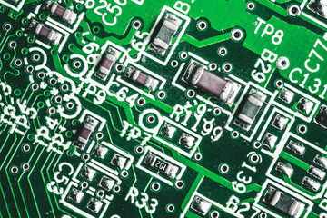 Green circuit board. Technology and electronics closeup background.