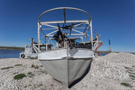 Fishing boat stranded on rocky shore