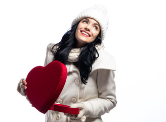 Happy young woman holding a big heart gift box on isolated on white background