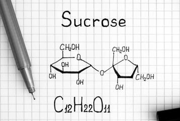 Chemical formula of Sucrose with black pen.