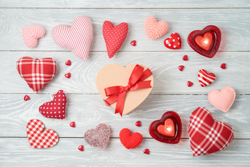 Valentine's day background with heart shapes, gift box  and  candles.