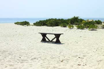 Isolated bench on a desert island (Ari Atoll, Maldives)