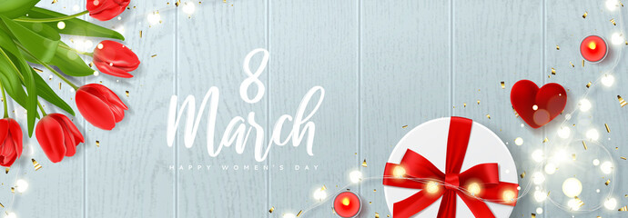 Happy Women's Day festive banner. Vector illustration with realistic red tulips flowers, ring box, gift box, candles, glowing light garland and golden confetti. Greeting card for 8 March.