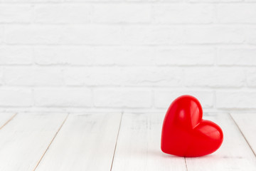 Red heart shaped on white wood background with copy space