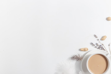 A cup of coffee with milk on a light background. Top view. Copy space.