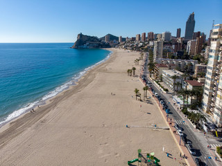Aerial photo taken in Benidorm in Spain Alicante, showing the beautiful beach of Playa Levante and hotels, buildings, and high rise skyline cityscape.