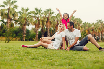 happy family playing and having fun near the palm trees