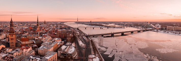 Wall Mural - Aerial winter sunset over Riga old town and river Daugava in Latvia.