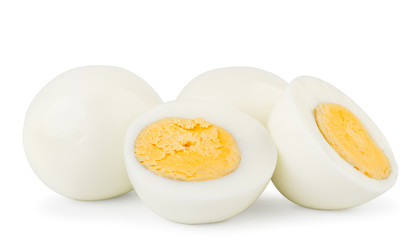 Boiled eggs and two halves close-up on a white. Isolated