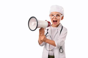 A  little, smiling boy doctor in  medical uniform, isolated on white, with stethoscope on the neck,  reminds you about health care and healthy lifestyle. Waist up portrait, looking at camera.