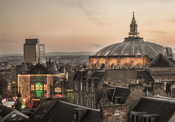 View of McEwan Hall's dome and Teviot House, of Edinburgh University, in the old town, from a roof top, with Christmas lights. Scotland, UK. Architecture. Student's Association
