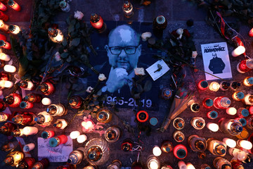 Candle lights and signs honouring Pawel Adamowicz, Gdansk mayor who died after being stabbed at charity event, are seen in the main square of Krakow