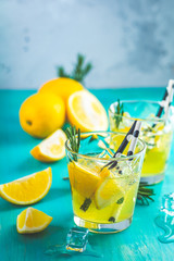 Cocktail with ice, lemon and rosemary herb