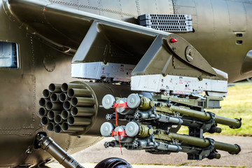 Military helicopter equipped with guided anti-tank missiles and aircraft missiles closeup