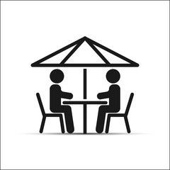 Two people sitting at a table under an umbrella, a simple picture