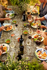 Family eating at outdoor dinner party