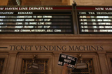 A sign is displayed at the Non-March for Disabled Women at Grand Central Station in New York City