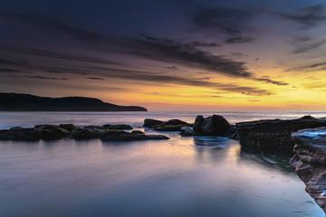 Dawn Sky over a Rocky Seascape