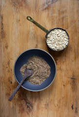 Bowl of whole grain uncooked oats and flax seed