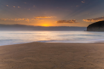 Sunrise Seascape the Beach and Low Cloud Bank