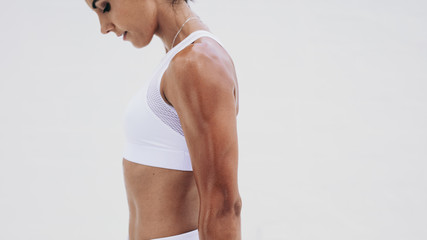 Close up of an athletic woman standing during workout