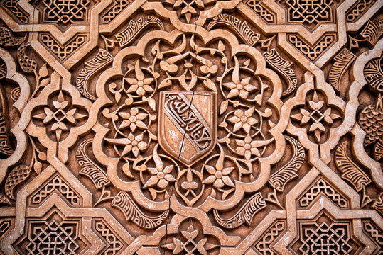 Detail of Islamic stone carving on a wall in the royal palace Nazaries of the Alhambra, Granada, Andalucia, Spain