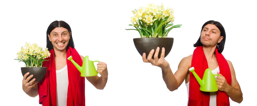 Young man watering flowers isolated on white