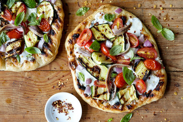 Homemade Grilled Pizza on wood surface