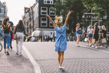 happy girl in blue dress in amsterdam.