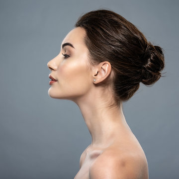 Beautiful woman cares for the skin neck