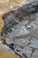 Boiling and bubbling grey mud pool at Hverir and Namaskard geothermal area, Diamond Circle, Iceland