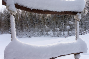 Rungs of a rope ladder covered in thick snow