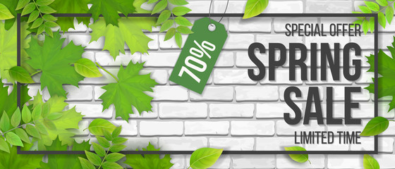 Spring sale. Green maple leaves, frame and typographics on white brick wall background. Template for invitation, discount offer or flyer. Realistic detailed vector.